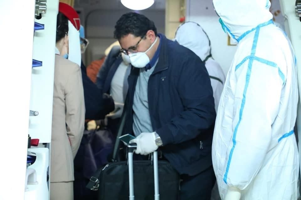 فحص الوفد المصري في مطار بكين
