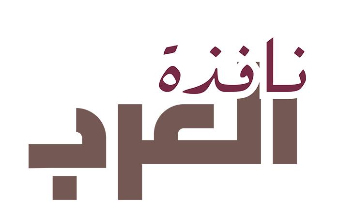 موظفون في مطار حمد الدولي - فرانس برس