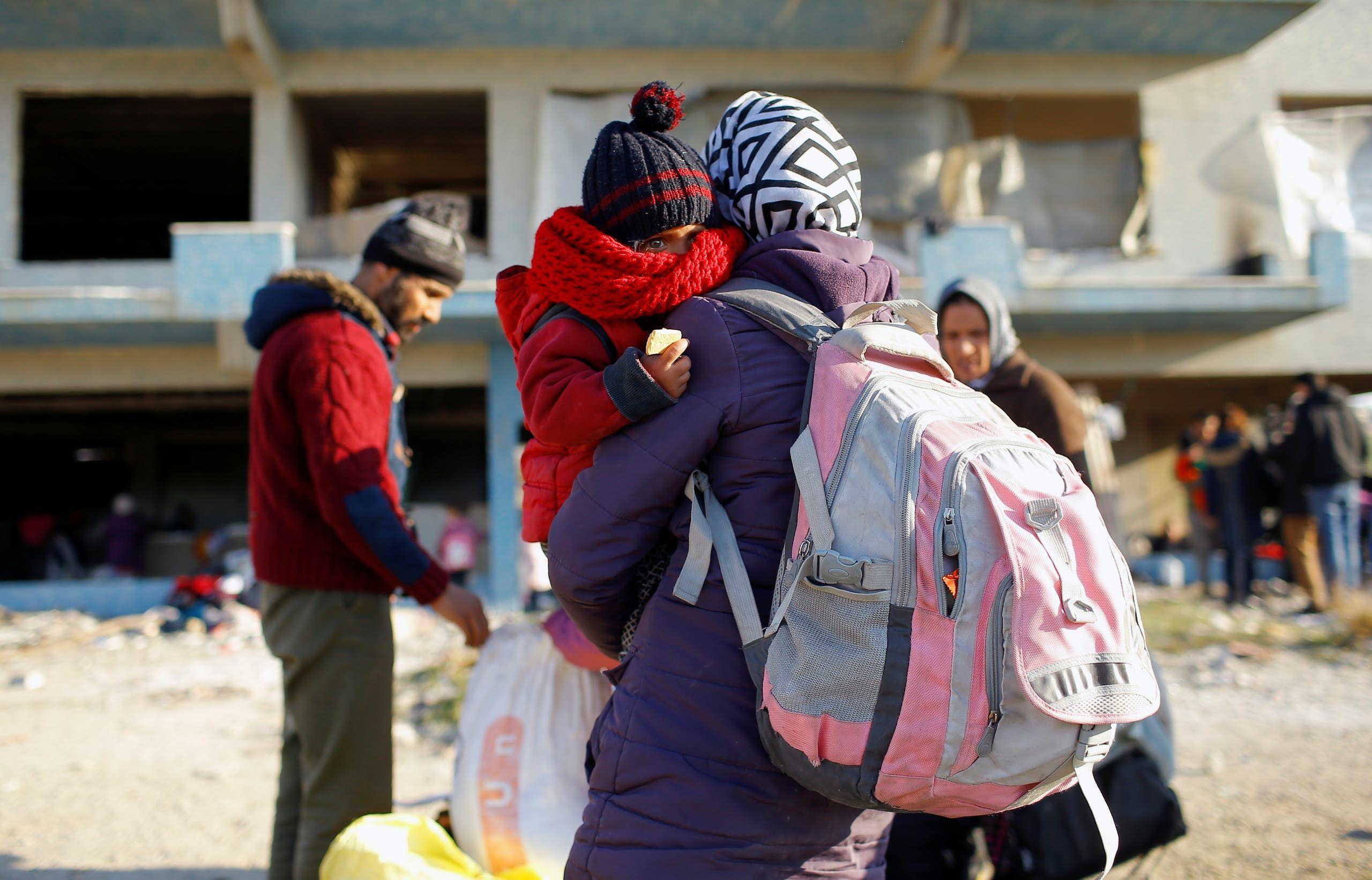 لاجئون سوريون (رويترز)