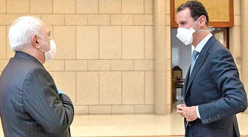 رئيس النظام السوري بشار الأسد وجواد ظريف وزير خارجية إيران