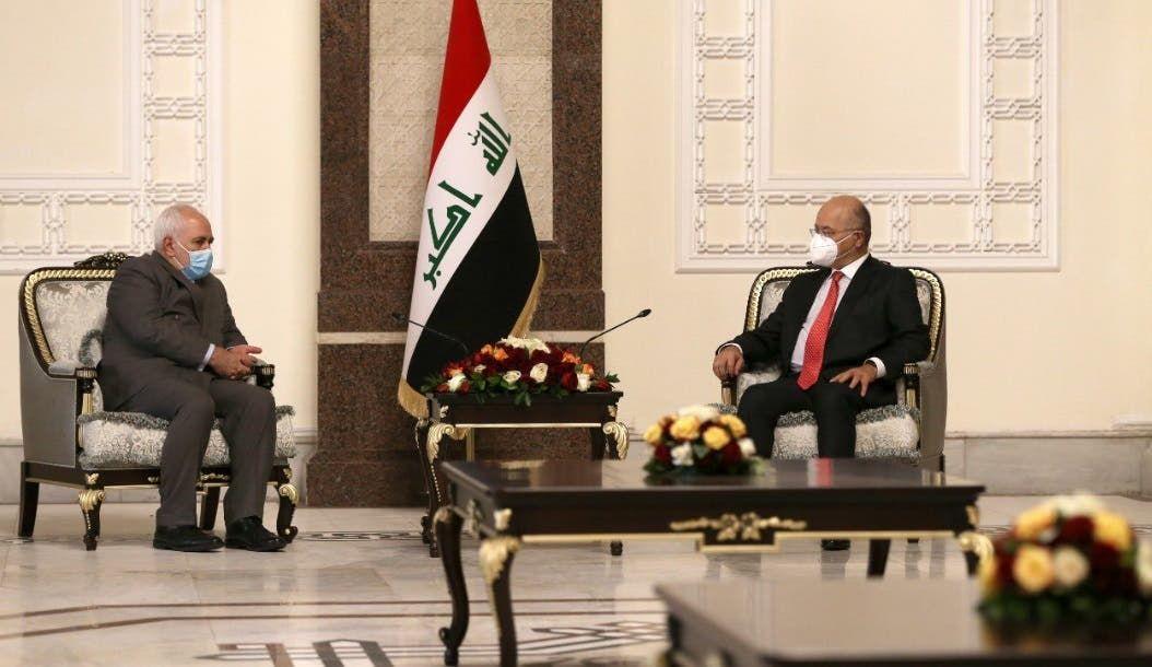 برهم صالح خلال لقائه محمد جواد ظريف في بغداد يوم 19 يوليو (فرانس برس)