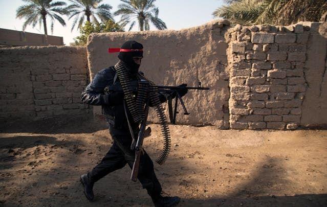 عنصر تابع للميليشيات العراقية المدعومة من إيران