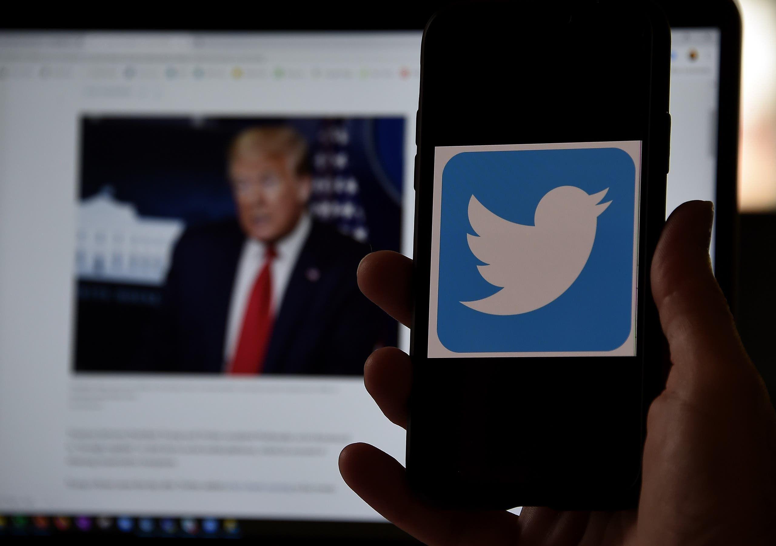 الرئيس الأميركي دونالد ترمب وتويتر (أرشيفية- فرانس برس)