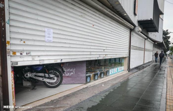 """إيران   صور من إيران.. محال نصف مفتوحة """"تحتال"""" على كورونا"""